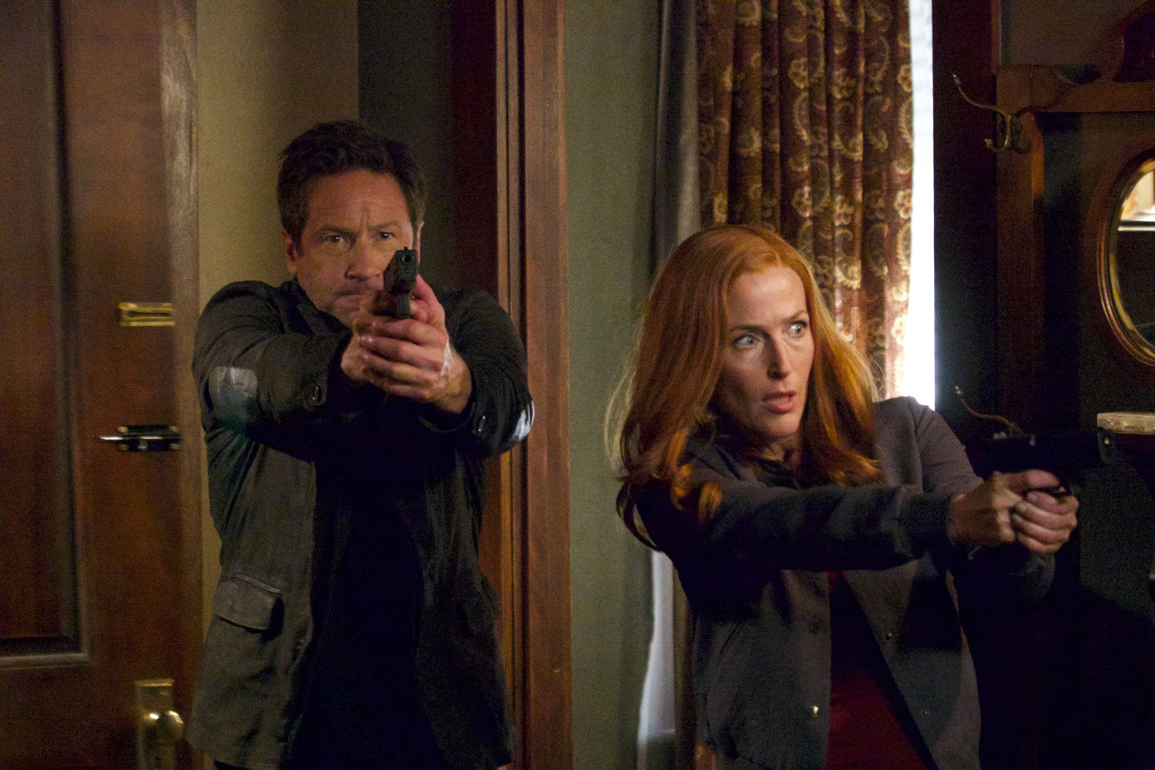 "THE X-FILES:  L-R:  David Duchovny and Gillian Anderson in the ""This"" episode of THE X-FILES airing Wednesday, Jan. 10 (8:00-9:00 PM ET/PT) on FOX. ©2017 Fox Broadcasting Co. Cr:  Shane Harvey/FOX"